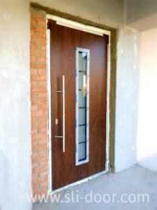 Двері Hörmann Thermo65 в мотиві 700 та кольорі Темний дуб (Dark Oak)